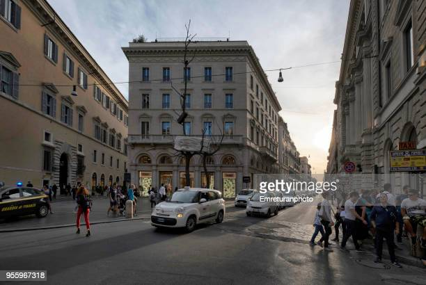 rome street junction with cars and pedestrian traffic at sunset. - emreturanphoto stock pictures, royalty-free photos & images