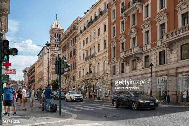 rome street with pedestrians and car traffic on a sunny day. - emreturanphoto stock pictures, royalty-free photos & images