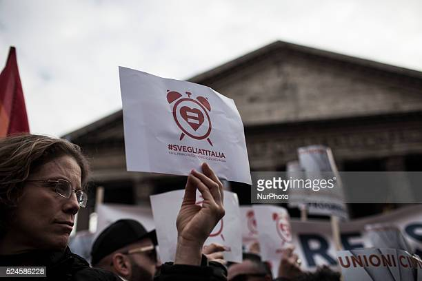 Supporters of samesex civil union hold placards during a demonstration called quotto wake up Italiaquot on January 23 2016 near the Pantheon in...