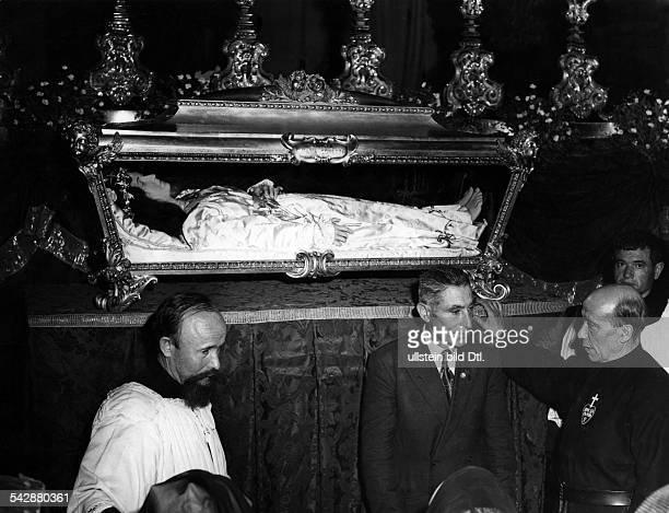 Rome Vatican coffin of Maria Goretti in the foreground Francis Spellman and Mariano Goretti