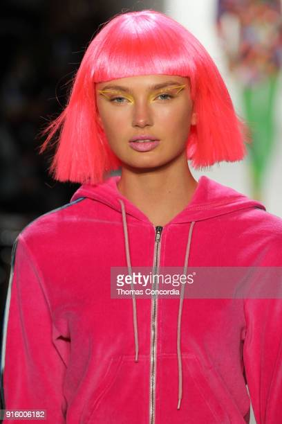 Romee Strijd walks the runway wearing Jeremy Scott Fall 2018 with make up by Kabuki for MAC and hair by Eugene Souleiman for Wella at Spring Studios...