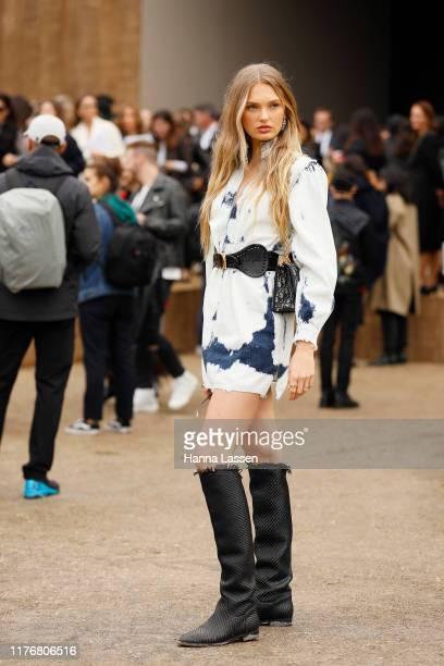 Romee Strijd wearing tiedie denim dress kneehigh boots and Dior bag on September 24 2019 in Paris France