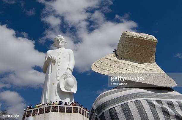 Romeiros e devotos visitam a Estátua de Padre Cícero durante romaria de finados em Juazeiro do Norte. | Pilgrims and devotees visit the statue of...