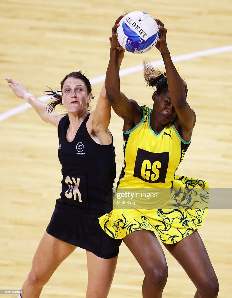 Romelda Aiken of Jamaica and Anna Scarlett of New Zealand compete for the ball during the Women Semifinals Match between New Zealand and Jamaica at the Thyagaraj Sports Complex during day nine of the 2010 Commonwealth Games on October 12, 2010 in Delhi, India.