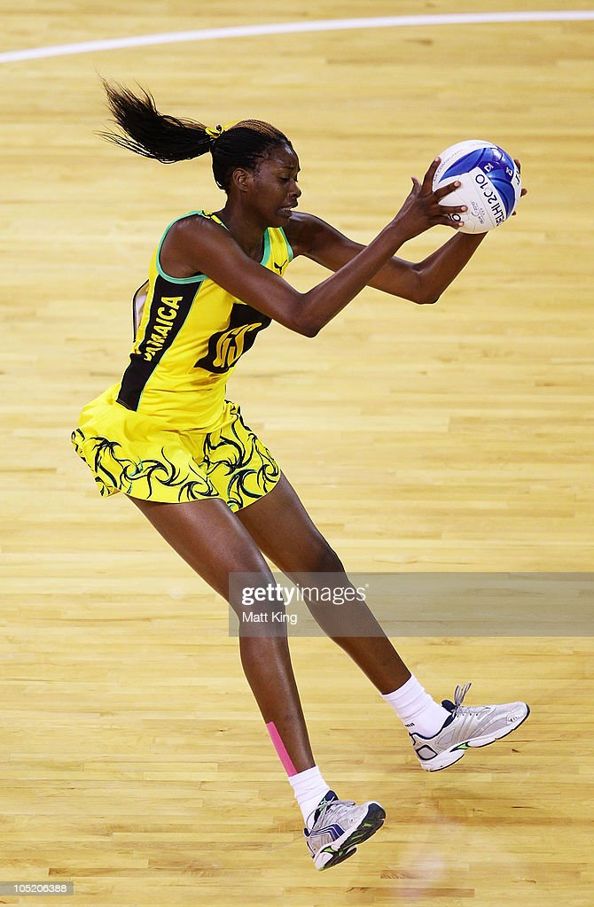 Romelda Aiken of Jamaica catches the ball during the Women Semifinals Match between New Zealand and Jamaica at the Thyagaraj Sports Complex during day nine of the 2010 Commonwealth Games on October 12, 2010 in Delhi, India.