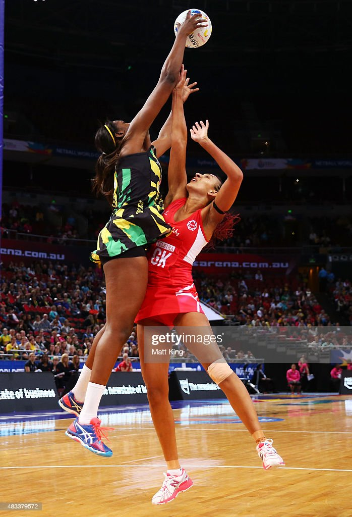 Romelda Aiken of Jamaica is challenged by Geva Mentor of England during the 2015 Netball World Cup match between England and Jamaica at Allphones Arena on August 8, 2015 in Sydney, Australia.