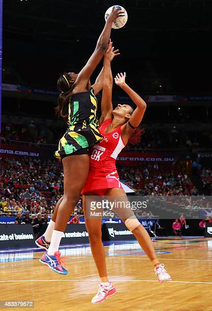 Romelda Aiken of Jamaica is challenged by Geva Mentor of England during the 2015 Netball World Cup match between England and Jamaica at Allphones...