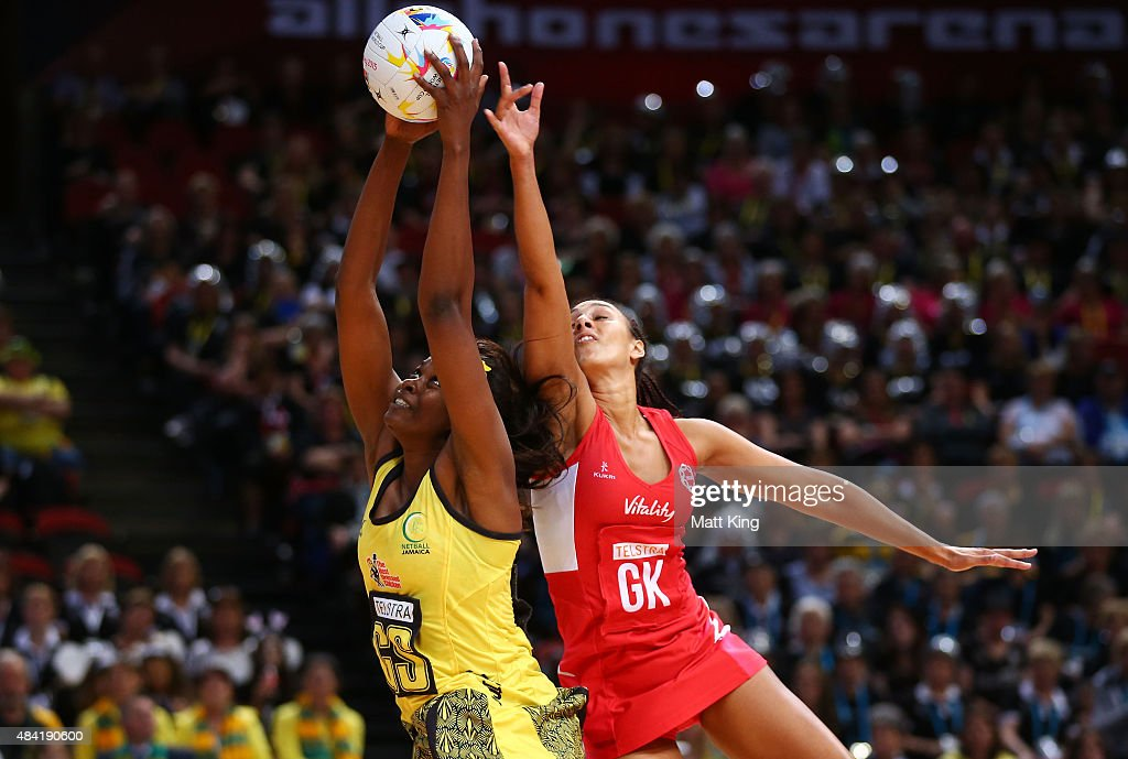 Romelda Aiken of Jamaica is challenged by Geva Mentor of England during the 2015 Netball World Cup Bronze Medal match between England and Jamaica at Allphones Arena on August 16, 2015 in Sydney, Australia.