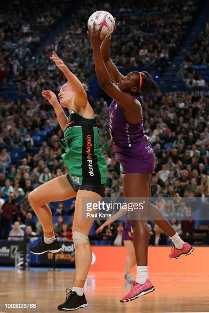 Romelda Aiken of the Firebirds catches a pass against Courtney Bruce of the Fever during the round 12 Super Netball match between the Fever and the...