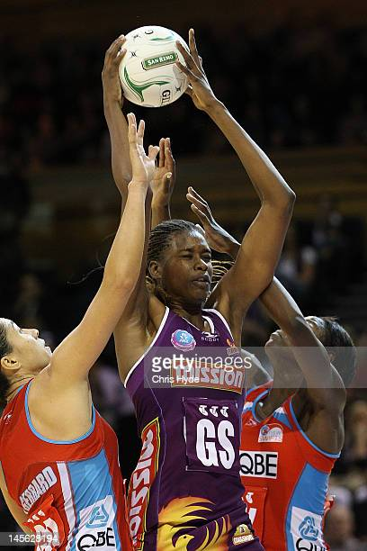 Romelda Aiken of the Firebirds catches the ball during the round 10 ANZ Championship match between the Firebirds and the Swifts at Brisbane...