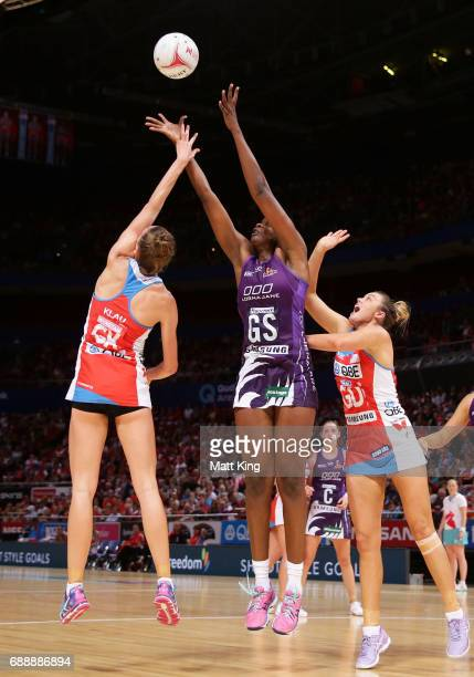 Romelda Aiken of the Firebirds catches the ball during the round 14 Super Netball match between the Swifts and the Firebirds at Qudos Bank Arena on...