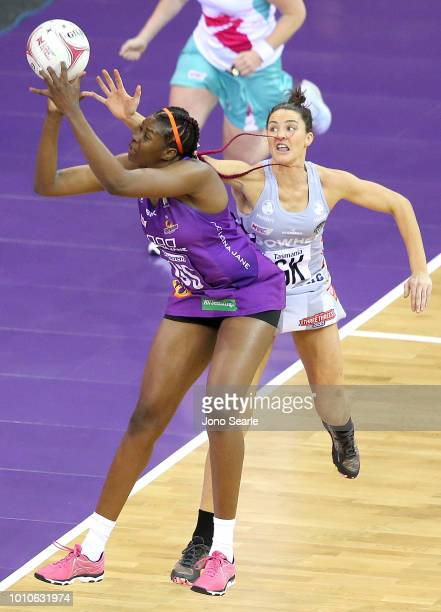 Romelda Aiken of the Firebirds competes with Sharni Layton of the Magpies during the round 14 Super Netball match between the Firebirds and the...
