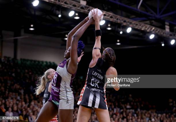 Romelda Aiken of the Firebirds is challenged by Sharni Layton of the Magpies during the round 10 Super Netball match between the Magpies and the...