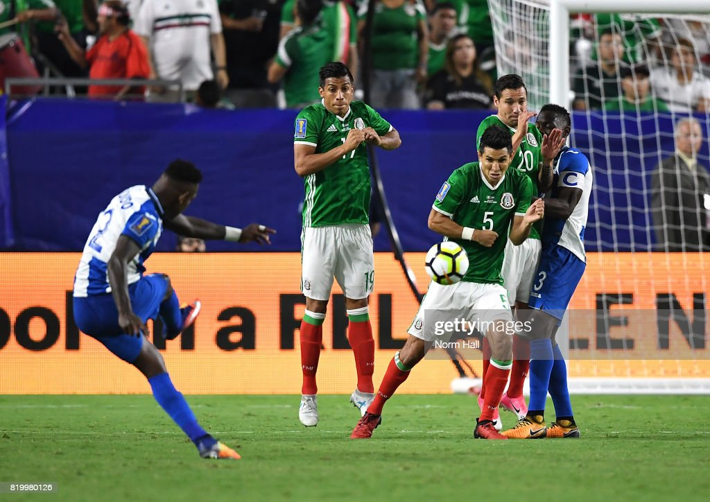 Romell Quioto #12 of Honduras takes a direct kick as Jesus Molina #5, Jorge Claros #20 and Marcelo Pereira #19 of Mexico attempt to block it during the second half in a quarterfinal match during the CONCACAF Gold Cup at University of Phoenix Stadium on July 20, 2017 in Glendale, Arizona. Mexico won 1-0.