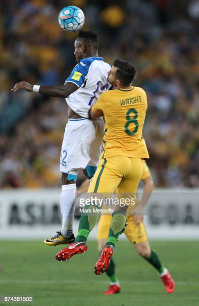 Romell Quioto of Honduras wins a header over Bailey Wright of Australia during the 2018 FIFA World Cup Qualifiers Leg 2 match between the Australian...
