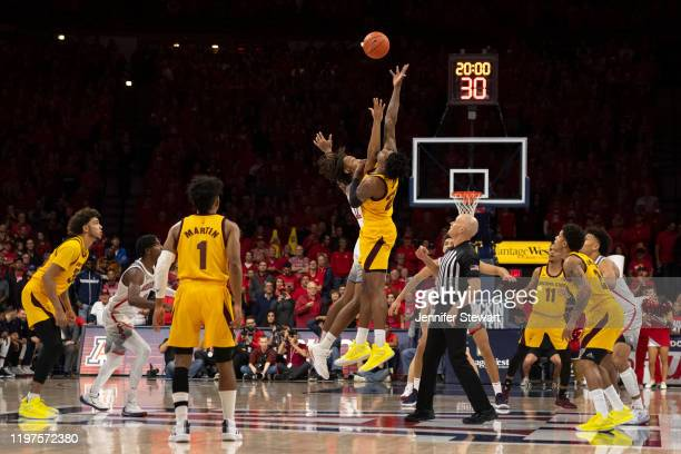 Romello White of the Arizona State Sun Devils and Zeke Nnaji of the Arizona Wildcats jump for the ball at tip off at McKale Center on January 04 2020...