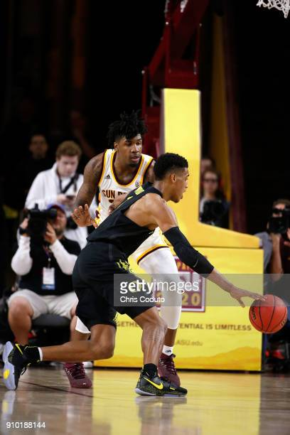 Romello White of the Arizona State Sun Devils defends Kenny Wooten of the Oregon Ducks during the first half of the college basketball game at Wells...