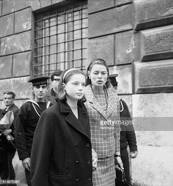 Rome:Looking just like a mother, Ingrid Bergman clutches her daughter, Isabella's hand as she convoys the 13-year old past some sailors during a...
