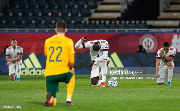 Romelu Lakaku of Belgium takes the knee ahead of the FIFA World Cup 2022 Qatar qualifying match between Belgium and Wales on March 24, 2021 in...