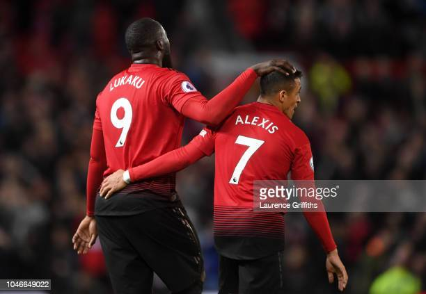 Romelu Lukaku and Alexis Sanchez of Manchester United celebrate following their sides victory in the Premier League match between Manchester United...