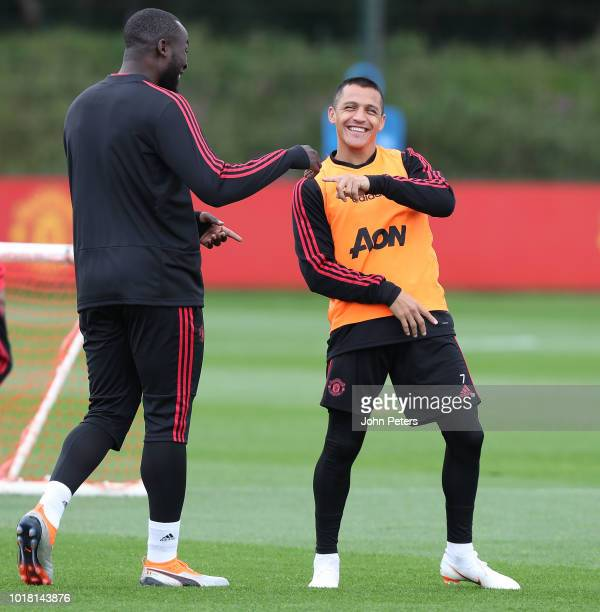 Romelu Lukaku and Alexis Sanchez of Manchester United in action during a first team training session at Aon Training Complex on August 17 2018 in...
