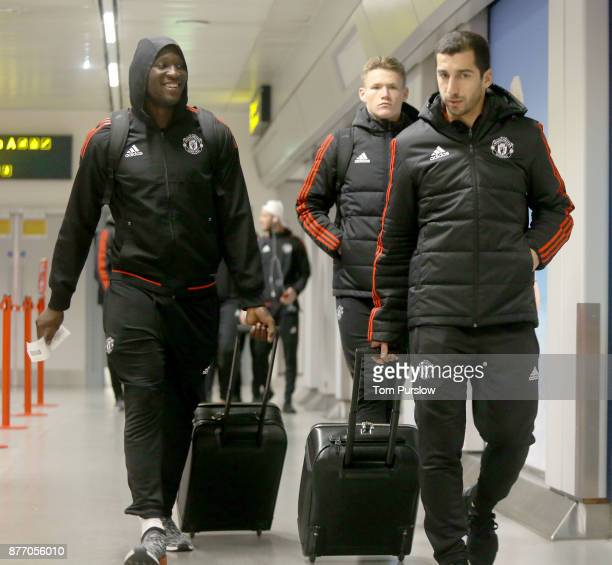 Romelu Lukaku and Henrikh Mkhitaryan of Manchester United check in ahead of their flight to Basel at Manchester Airport on November 21 2017 in...