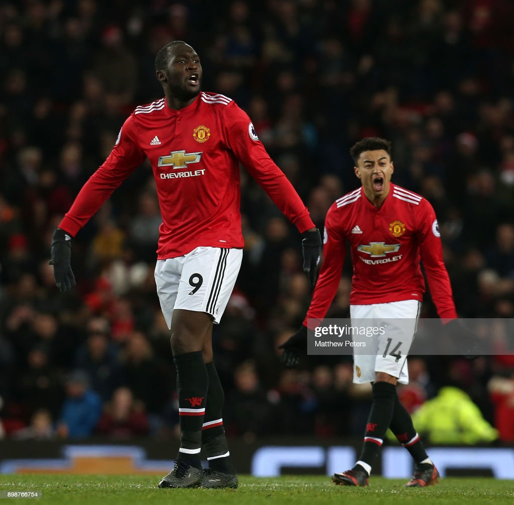 Romelu Lukaku and Jesse Lingard of Manchester United get the crowd going after Jesse Lingard scored their second goal during the Premier League match between Manchester United and Burnley at Old Trafford on December 26, 2017 in Manchester, England.
