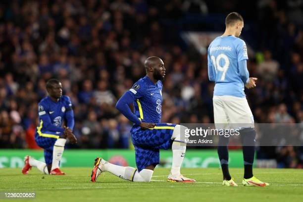 Romelu Lukaku and N'Golo Kante of Chelsea take a knee as Veljko Birmancevic of Malmo opts to stand during the UEFA Champions League group H match...