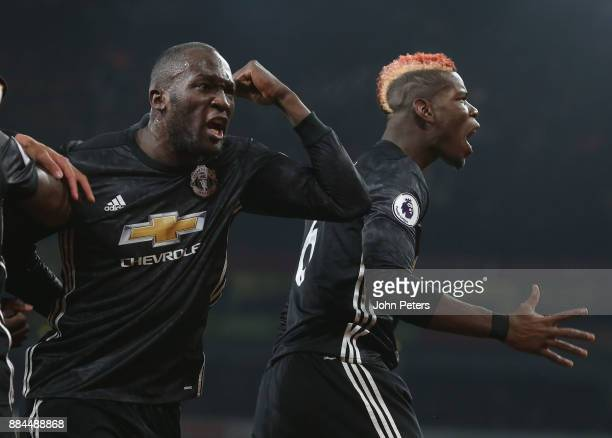 Romelu Lukaku and Paul Pogba of Manchester United celebrate Jesse Lingard scoring their second goal during the Premier League match between Arsenal...