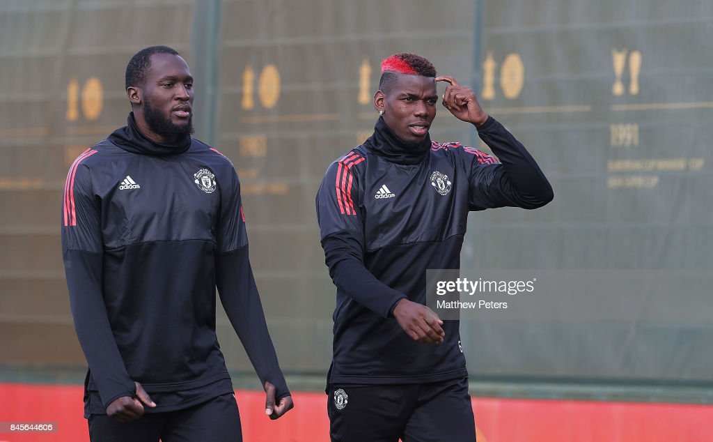 Romelu Lukaku and Paul Pogba of Manchester United in action during a first team training session at Aon Training Complex on September 11, 2017 in Manchester, England.