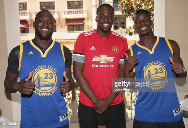 Romelu Lukaku and Paul Pogba of Manchester United pose with Draymond Green of Golden State Warriores as part of their preseason tour of the USA at...