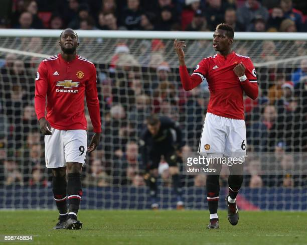 Romelu Lukaku and Paul Pogba of Manchester United react to conceding a goal to Steven Defour of Burnley during the Premier League match between...