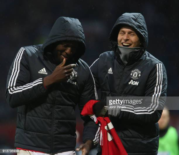 Romelu Lukaku and Victor Lindelof of Manchester United walk off after the Premier League match between Manchester United and Huddersfield Town at Old...