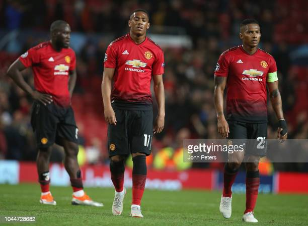 Romelu Lukaku Anthony Martial and Antonio Valencia of Manchester United walk off after the Group H match of the UEFA Champions League between...