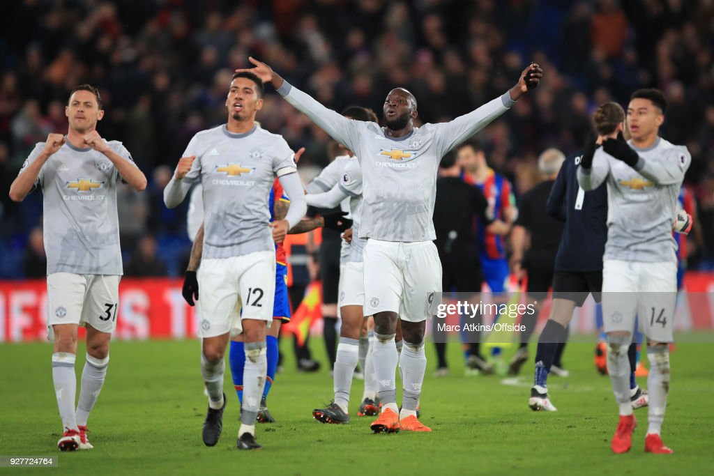 Romelu Lukaku, Chris Smalling and Nemanja Matic and Jesse Lingard of Manchester United lead the celebrations during the Premier League match between Crystal Palace and Manchester United at Selhurst Park on March 5, 2018 in London, England.