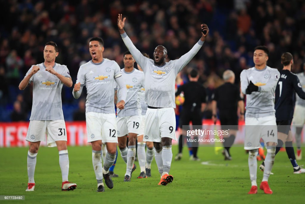 Romelu Lukaku, Chris Smalling and Nemanja Matic of Manchester United lead the celebrations during the Premier League match between Crystal Palace and Manchester United at Selhurst Park on March 5, 2018 in London, England.