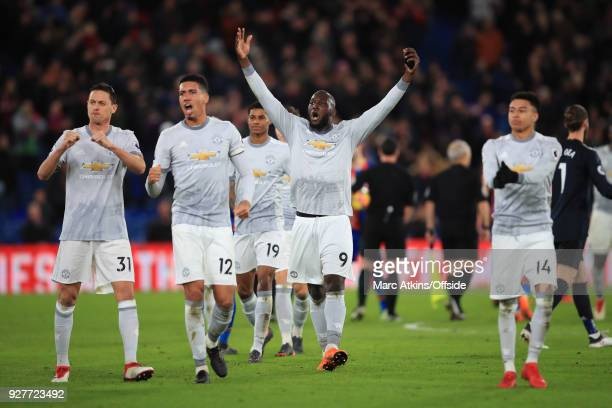 Romelu Lukaku Chris Smalling and Nemanja Matic of Manchester United lead the celebrations during the Premier League match between Crystal Palace and...