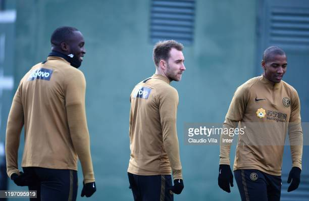 Romelu Lukaku, Christian Eriksen and Ashley Young look on during a FC Internazionale training session at Appiano Gentile on January 28, 2020 in Como,...