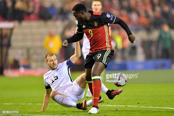 Romelu Lukaku forward of Belgium battles for the ball with Ragnar Klavan defender of Estonia during the World Cup Qualifier Group H match between...
