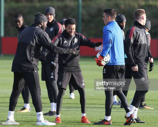 Romelu Lukaku Jesse Lingard and Joel Pereira of Manchester United in action during a training session at Aon Training Complex on October 30 2017 in...