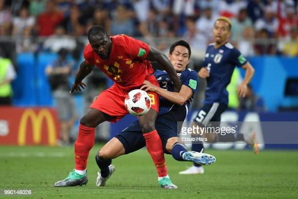 Romelu Lukaku of Belgium and Gen Shoji of Japan compete for the ball during the 2018 FIFA World Cup Russia Round of 16 match between Belgium and...