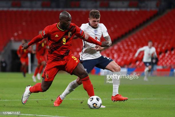 Romelu Lukaku of Belgium battles for possession with Kieran Trippier of England during the UEFA Nations League group stage match between England and...