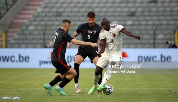 Romelu Lukaku of Belgium battles for the ball with Mateo Kovacic of Croatia and Duje Caleta-Car of Croatia during the international friendly match...