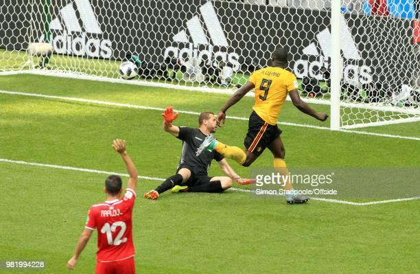 Romelu Lukaku of Belgium beats Tunisia goalkeeper Farouk Ben Mustapha to score his second goal during the 2018 FIFA World Cup Russia Group G match...