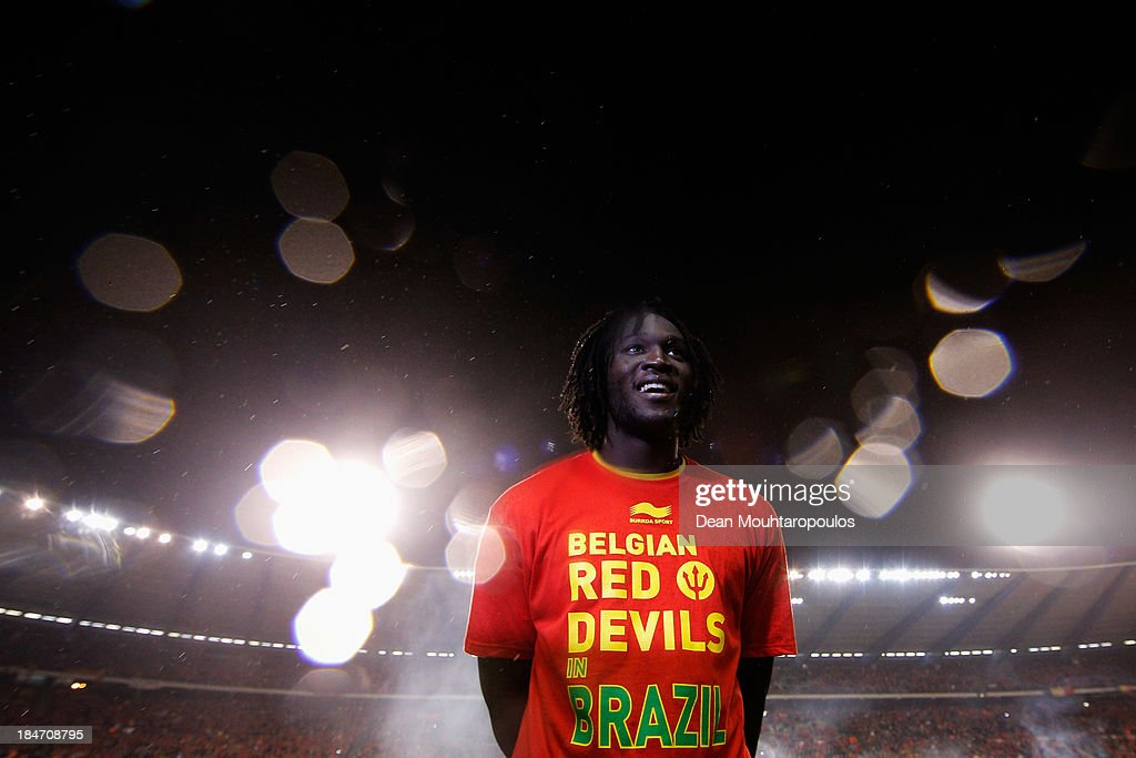 Romelu Lukaku of Belgium celebrates and waits for his TV interview after the FIFA 2014 World Cup Qualifying Group A match between Belgium and Wales at King Baudouin Stadium on October 15, 2013 in Brussels, Belgium.