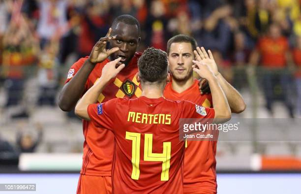 Romelu Lukaku of Belgium celebrates his second and winning goal with Dries Mertens and Eden Hazard during the UEFA Nations League A group two match...