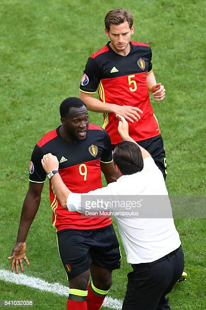 Romelu Lukaku of Belgium celebrates scoring his team's first goal with Marc Wilmots manager of Belgium during the UEFA EURO 2016 Group E match...