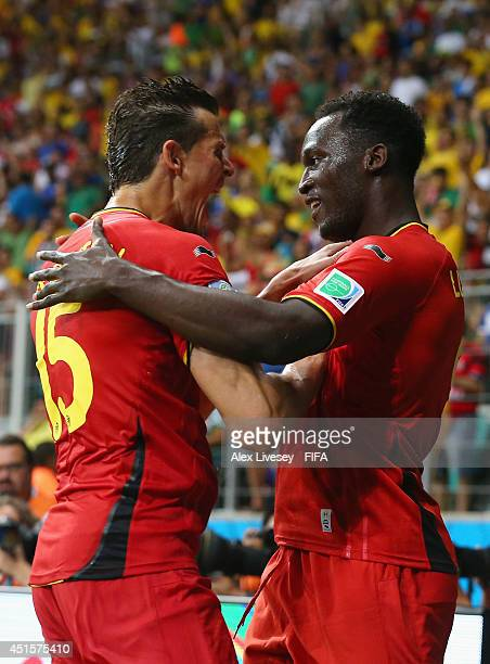 Romelu Lukaku of Belgium celebrates scoring his team's second goal with his teammate Daniel Van Buyten during the 2014 FIFA World Cup Brazil Round of...