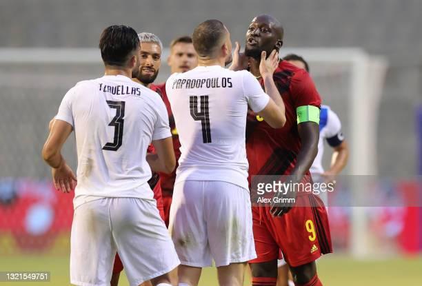 Romelu Lukaku of Belgium clashes with Giorgos Tzavellas and Kyriakos Papadopoulos of Greece during the international friendly match between Belgium...