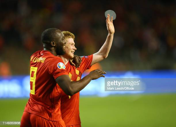 Romelu Lukaku of Belgium congratulates Kevin de Bruyne of Belgium after the third goal during the UEFA Euro 2020 qualifying match between Belgium and...